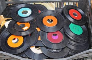 Some Vinyl Records (being compared to Digital Phone Systems)